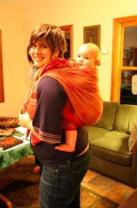 wearing baby in a sling